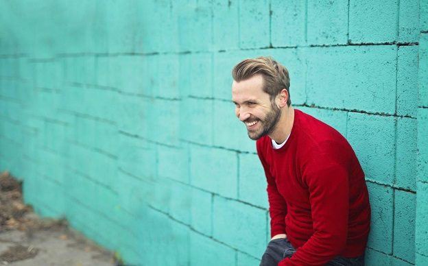 A man in a red sweater
